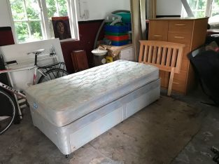 Single bed with wooden headboards