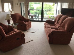 Two three seater recliner sofas